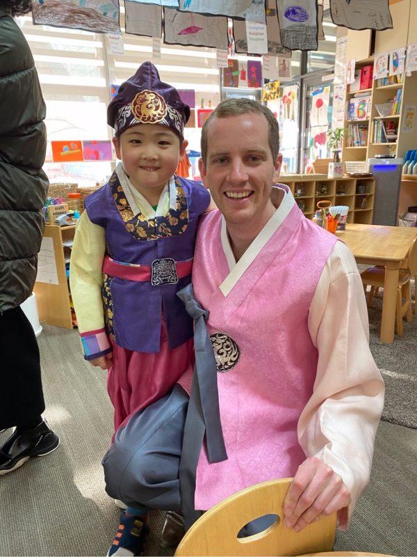 International school teacher with student