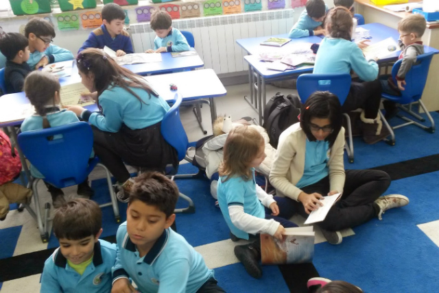 Y6C reading with the Year 1 children