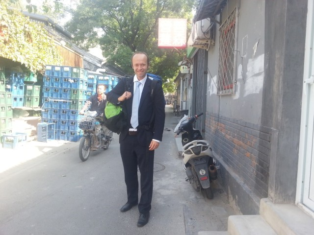 Alexis in the Hutongs ready for a meeting at The Beijing British School. Notice the backpack (s) – doesn't quite fit with the suit!